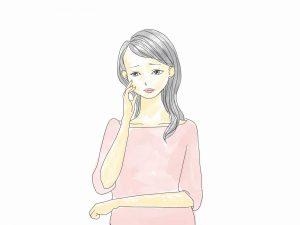 頬に手をかけて悩む女性の絵