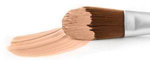 コンシーラーをブラシで塗っているイメージ